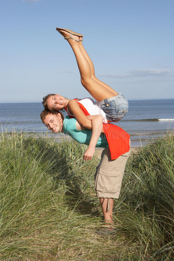 Download Energetic Young Couple Having Fun In Dunes Stock Image - Image: 13672899