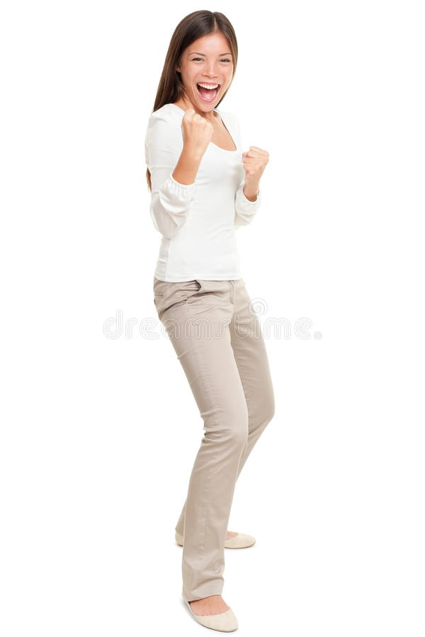Energetic Young Woman Clenching Fists. Full length portrait of energetic young woman clenching fists standing isolated over white background royalty free stock photos