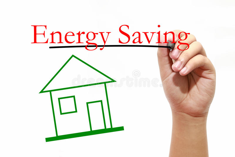 Energi - besparing - hus med text- och manhanden med pennan arkivbild
