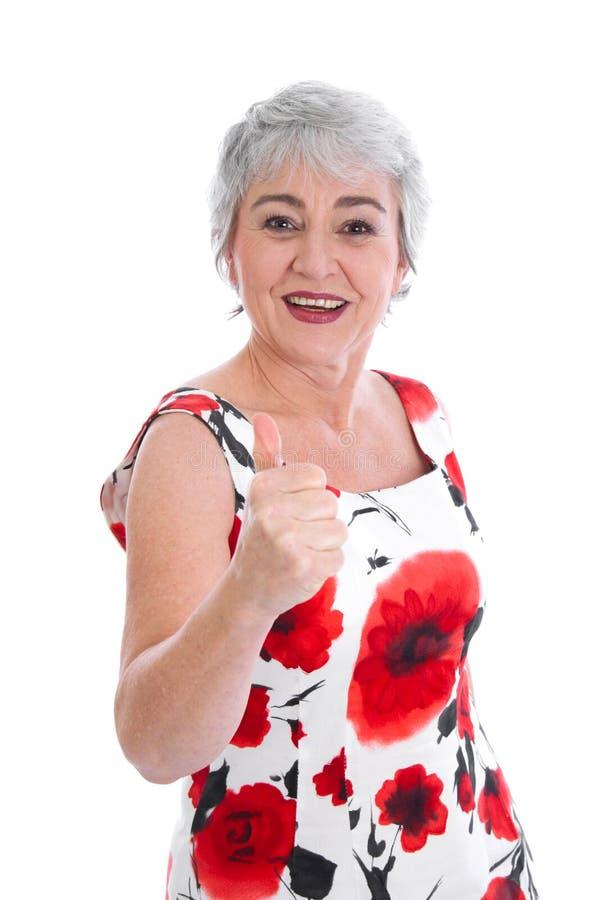 Energie und Freude am Leben im hohen Alter. Ältere Frauendaumen oben. lizenzfreie stockbilder