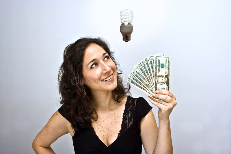 Energiesparendes Geld stockbild