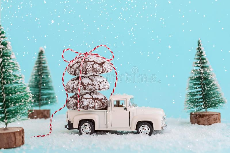 ENERGODAR, UKRAINE - January, 2019: Chocolate cookies wrapped with ribbon on roof of white toy car. - Image. ENERGODAR, UKRAINE - January, 2019: Chocolate royalty free stock images