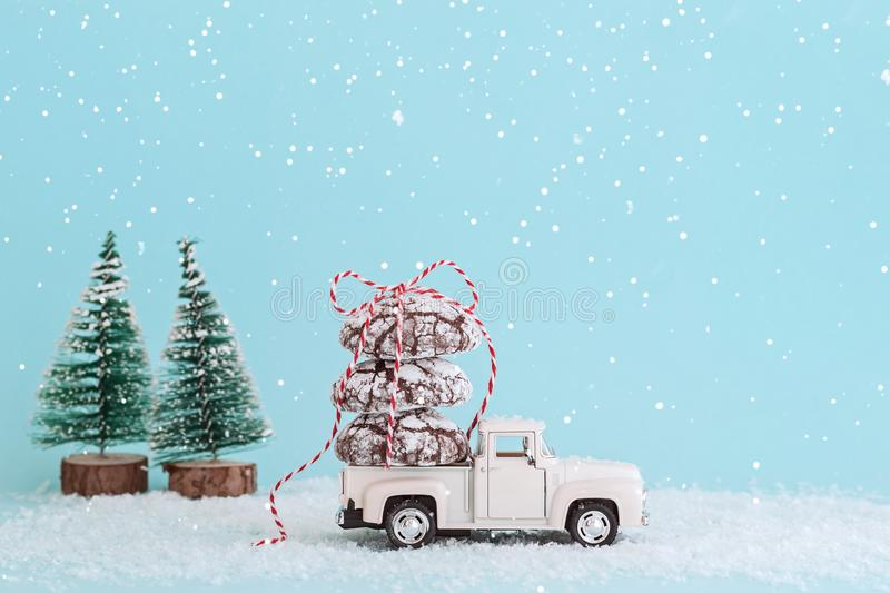 ENERGODAR, UKRAINE - January, 2019: Chocolate cookies wrapped with ribbon on roof of white toy car. - Image. ENERGODAR, UKRAINE - January, 2019: Chocolate royalty free stock image