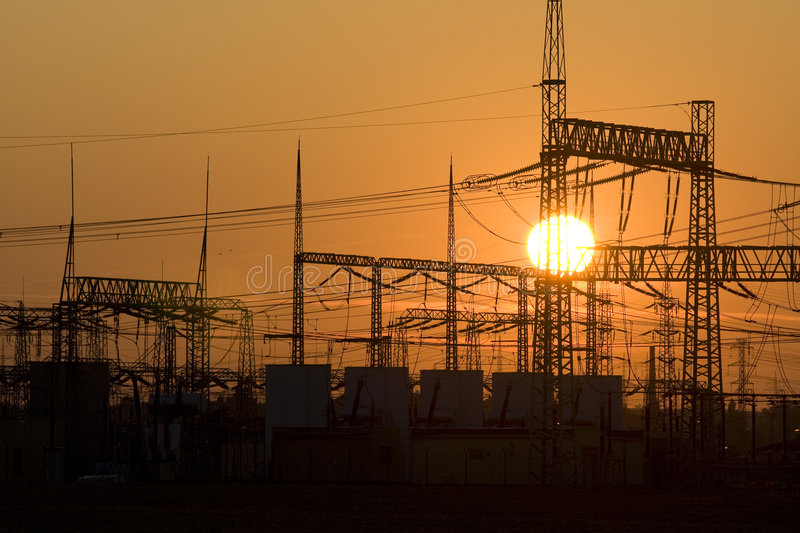 Energy. Solar energy versus electrical energy - sunset and network system of high voltage stock image