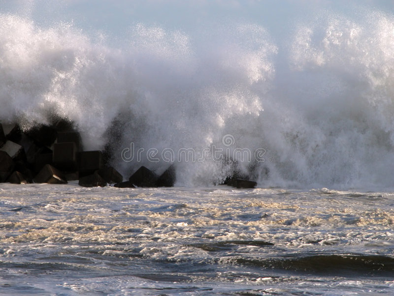 Energy. Powerful ocean waves breaking on the shore stock photo