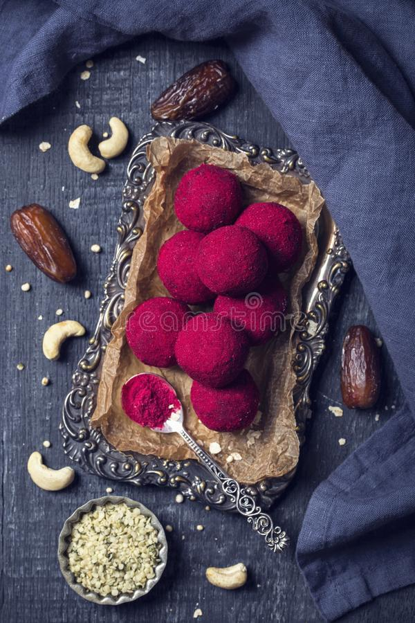 Energy balls with medjool dates. Nuts and raspberry powder royalty free stock photo