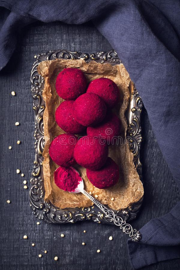 Energy balls with medjool dates, nuts. And rasberry powder stock photography