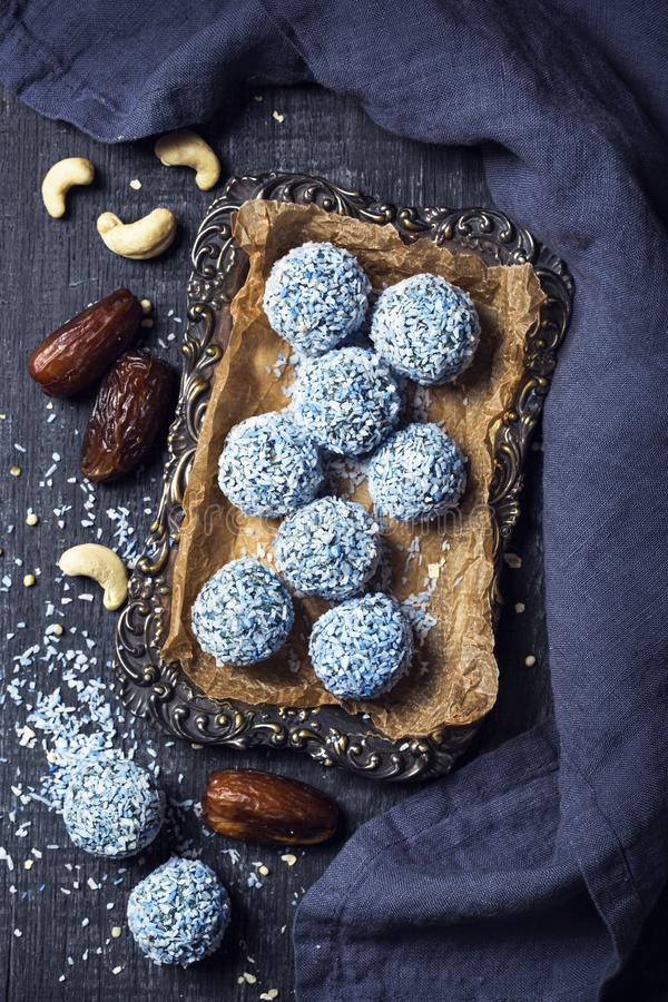 Energy balls with nuts, hemp hearts and  blue spirulina royalty free stock image
