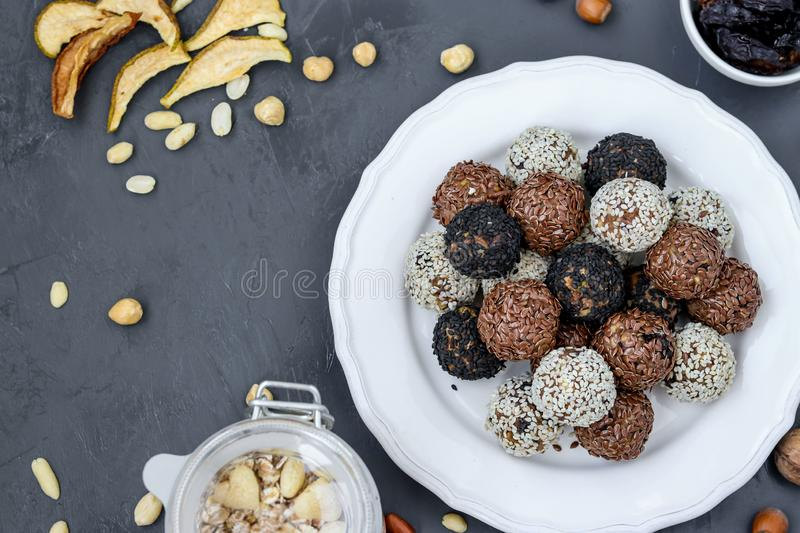 Energy balls of nuts, oatmeal and dried fruits on a plate on dark background, horizontal orientation. Top view royalty free stock photography