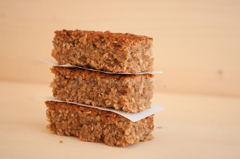 Energy bars. Homemade energy bars placed on aa wooden table stock photography
