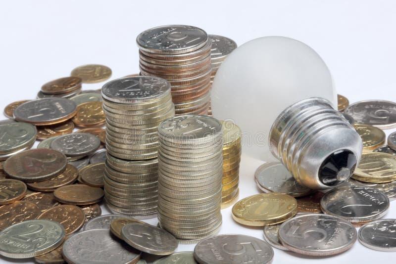 Energy concept. Concept, symbolizing economic inefficiency of glow lamp stock photos