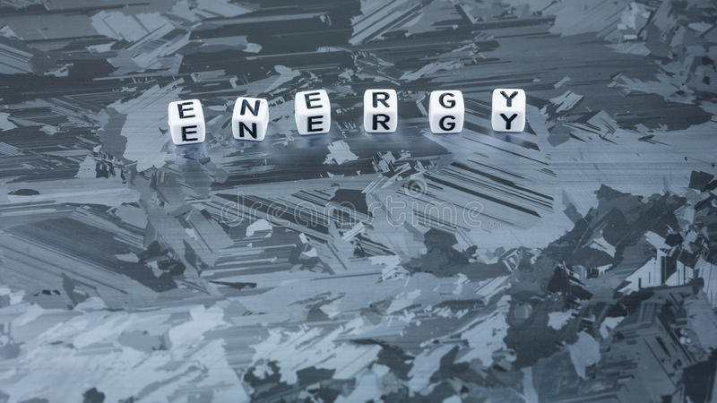 ENERGY cube letter on solar silicon cell surface. Concept of renewable clean energy royalty free stock image