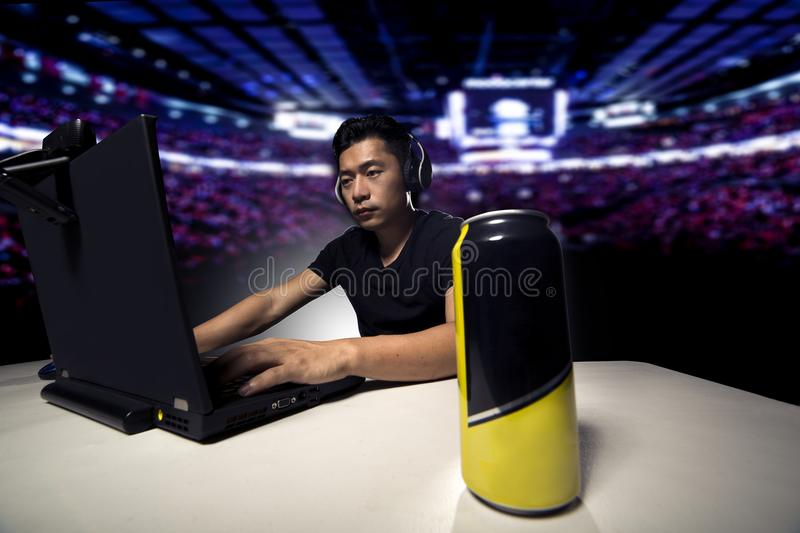 Energy Drink for eSport Gamer. Competitive eSport video game player drinking a canned energy drink as a stimulant. These beverage often contain caffeine and royalty free stock images