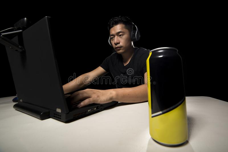Energy Drink for eSport Gamer. Competitive eSport video game player drinking a canned energy drink as a stimulant. These beverage often contain caffeine and stock photo