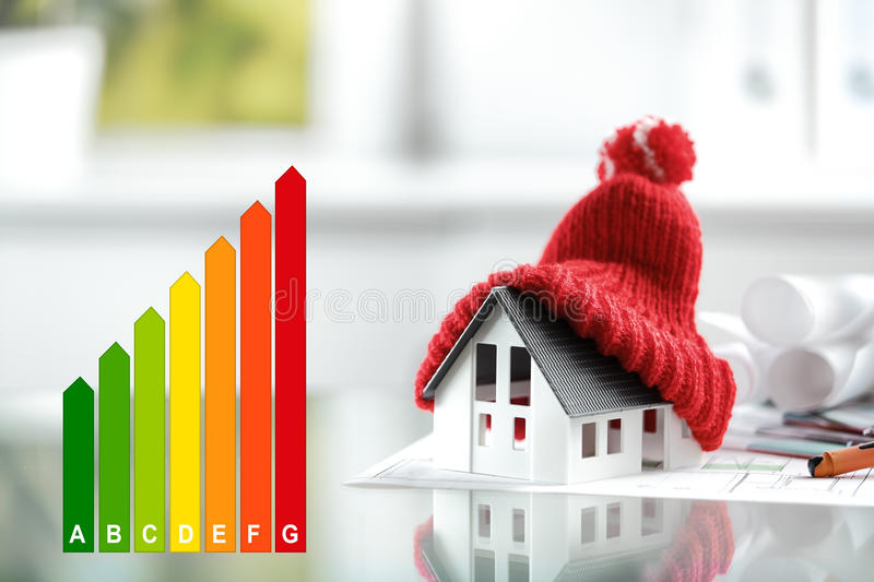 Energy efficiency concept with energy rating chart. And a house with red bobble hat stock photos