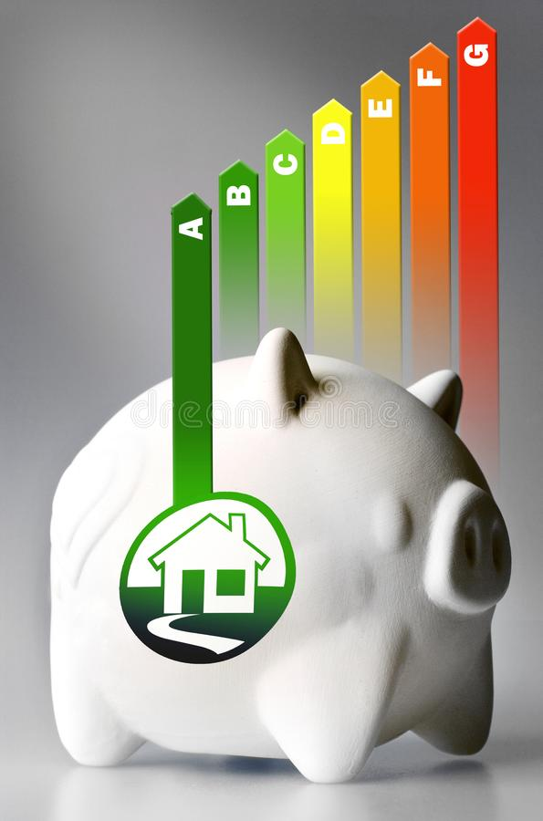 Energy efficiency label for house / heating and money savings - piggy bank on the grey background stock photo