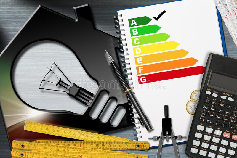 Energy Efficiency Rating with Calculator and House stock photos