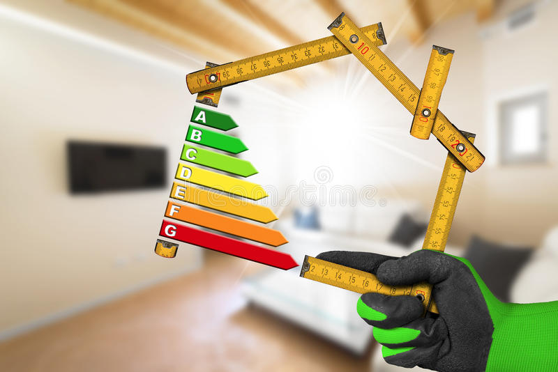 Energy Efficiency - Ruler in the Shape of House royalty free stock images