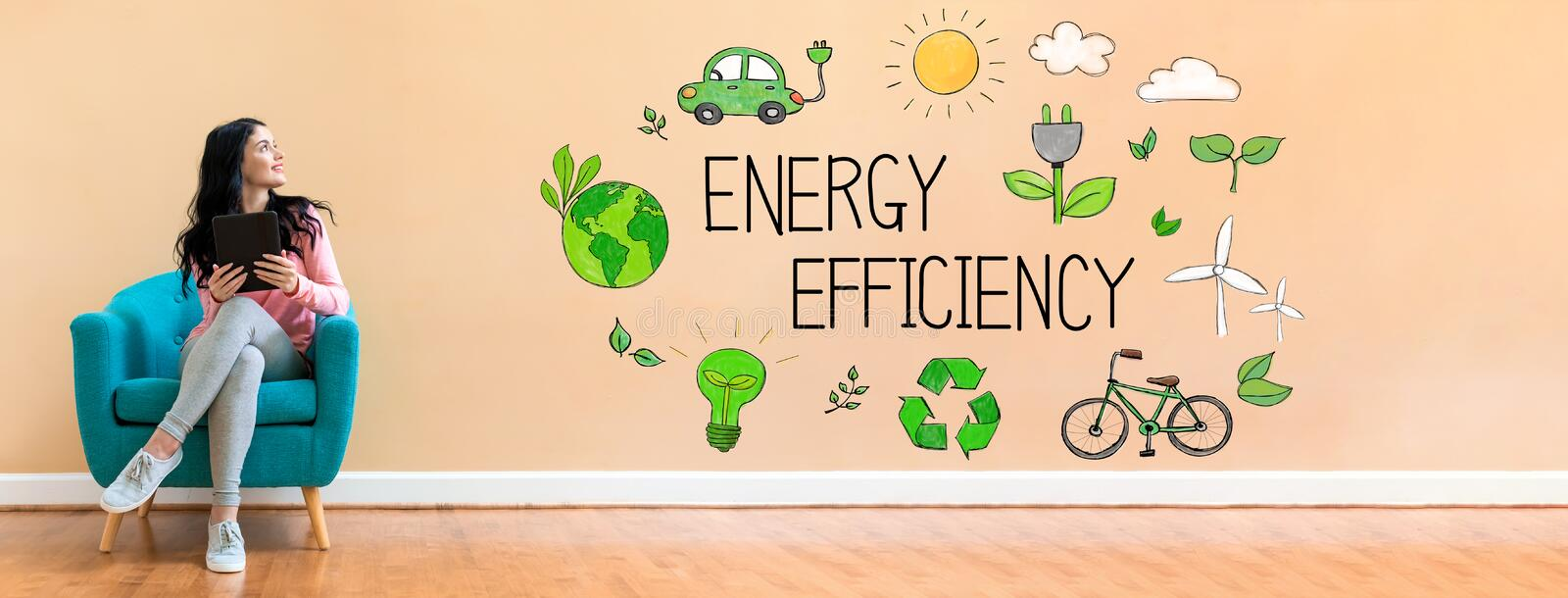 Energy efficiency with woman using a tablet royalty free stock photos