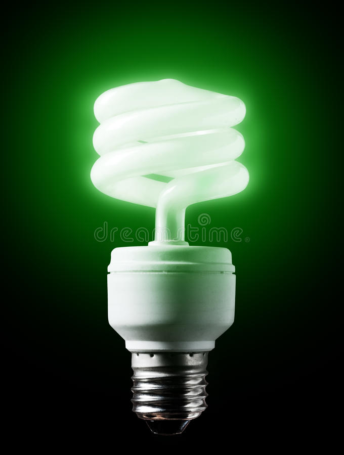 Energy-efficient green bulb. Energy-efficient green bulb shining black background stock photos
