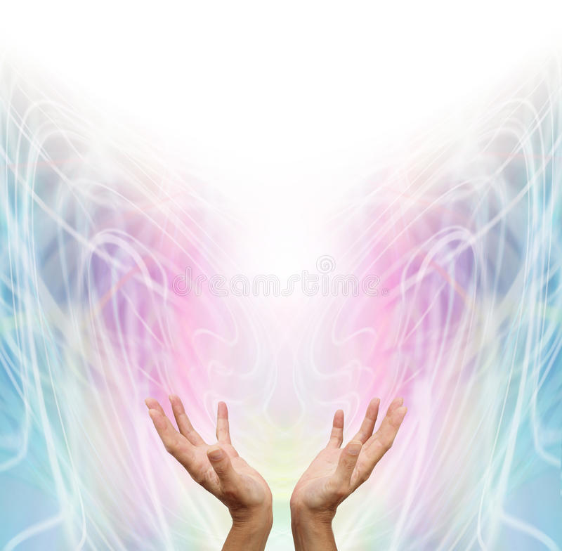 Energy Healer. Female energy worker with hands outstretched and open upwards sensing healing energy on pastel rainbow colored swirling energy formation royalty free stock photo