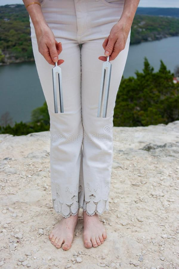 Free Energy Healer Holding Tuning Forks Royalty Free Stock Photography - 158801407
