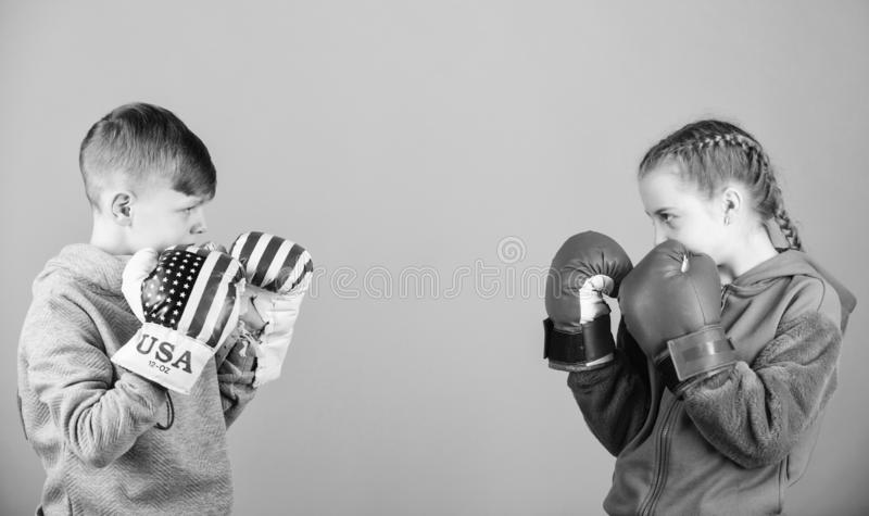 Energy health. punching knockout. Childhood activity. Sport success. Friendship fight. workout of small girl and boy. Boxer. Happy children in boxing gloves stock photography