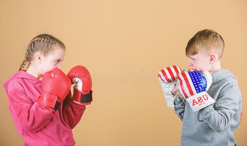 Energy health. punching knockout. Childhood activity. Sport success. Friendship fight. workout of small girl and boy. Boxer. Happy children in boxing gloves stock photo