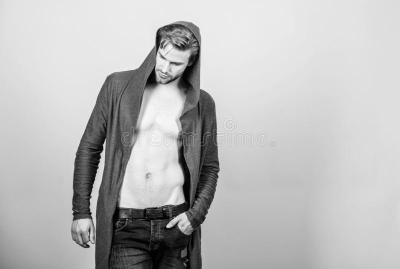 Energy inside. male fashion and beauty. sexy macho in denim style. fitness dieting for good shape. Guy fashion model. Man in trendy hooded jacket. perfect abs royalty free stock images