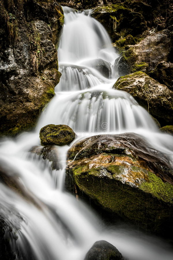 Energy, movement: Moving water, energy, waterfall Stream royalty free stock images