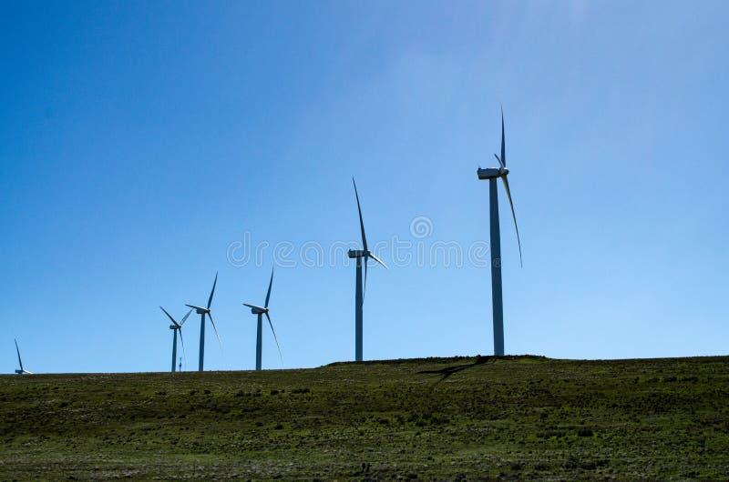 Energy producing wind farm turbines stock images