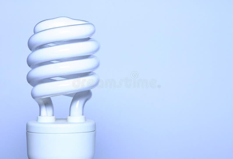 Energy saver - blue light bulb royalty free stock photos