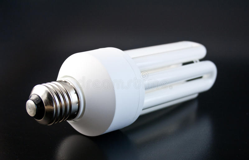 Energy saver lamp 5. Energy saver lamp on a black ground stock image