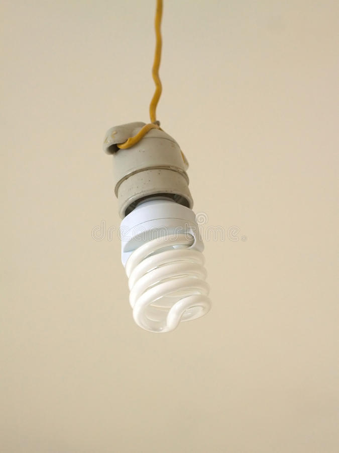 Energy saving bulb hangs closeup
