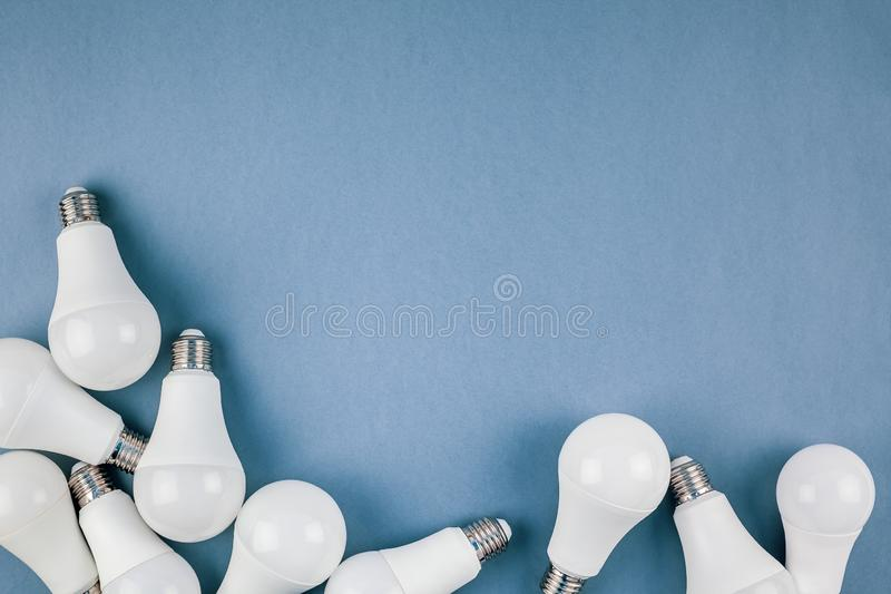 Energy saving and eco friendly LED light bulbs. Energy-saving and eco-friendly life in conceptual frame pattern. Creative top view flat lay of LED light bulbs stock image