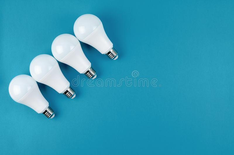 Energy saving and eco friendly LED light bulbs. Energy-saving and eco-friendly life in conceptual frame pattern. Creative top view flat lay of LED light bulbs stock photo