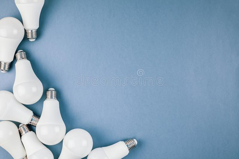 Energy saving and eco friendly LED light bulbs. Energy-saving and eco-friendly life in conceptual frame pattern. Creative top view flat lay of LED light bulbs royalty free stock photo