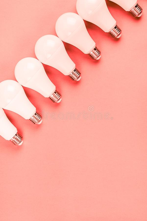 Energy saving and eco friendly LED light bulbs. Energy-saving and eco-friendly life in conceptual frame pattern. Creative top view flat lay of LED light bulbs stock photography