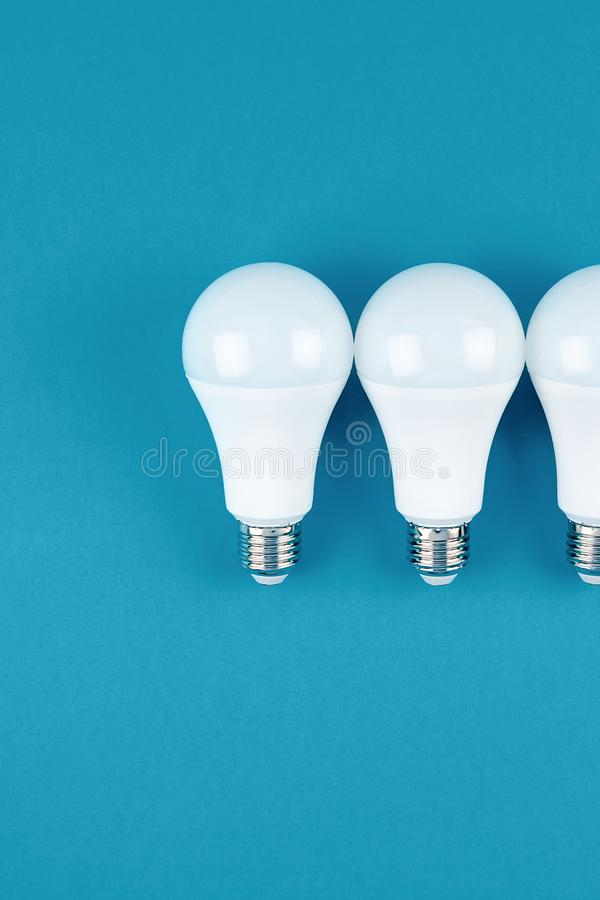 Energy saving and eco friendly LED light bulbs. Energy-saving and eco-friendly life in conceptual frame pattern. Creative top view flat lay of LED light bulbs royalty free stock image