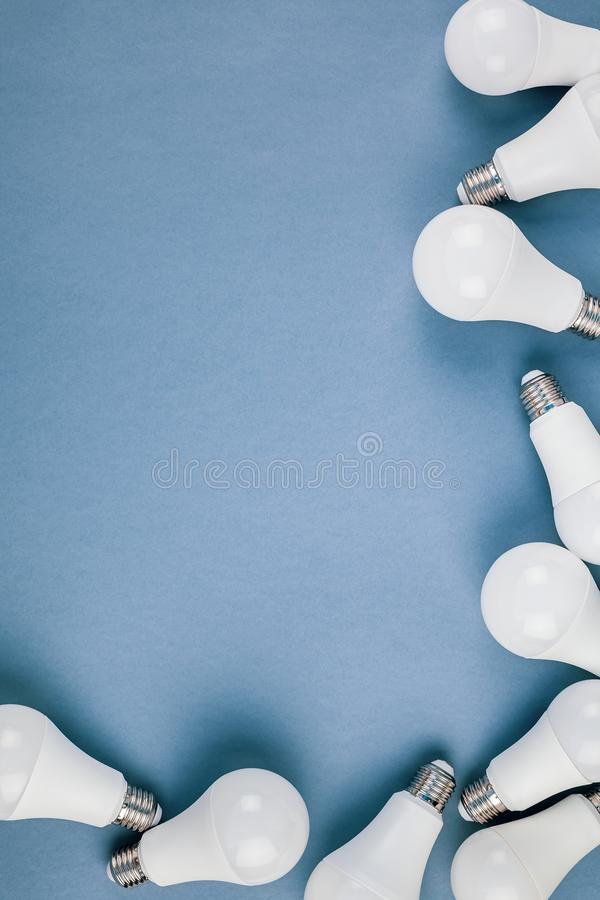 Energy saving and eco friendly LED light bulbs. Energy-saving and eco-friendly life in conceptual frame pattern. Creative top view flat lay of LED light bulbs royalty free stock photography