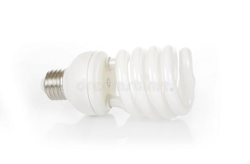 Energy saving fluorescent light bulb. On white background stock images