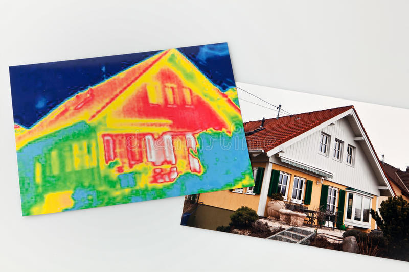 Energy saving. house with thermal imaging camera stock images