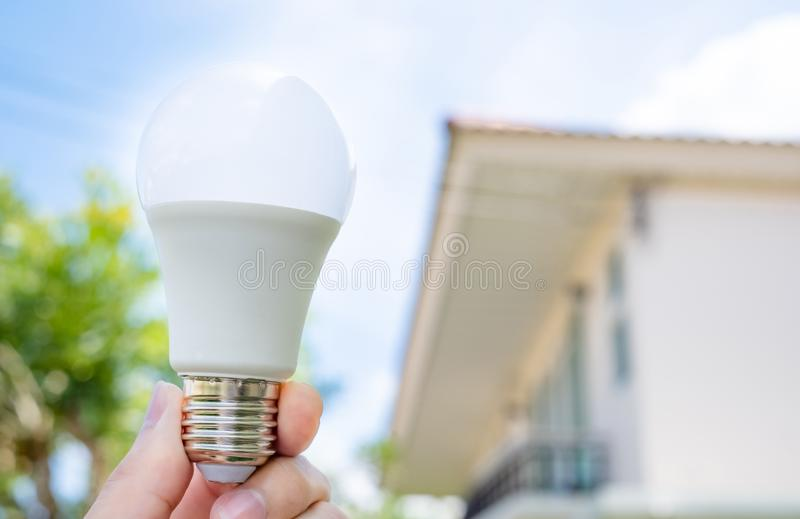 Energy saving lamp With the environment stock images