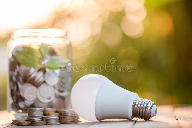 Energy saving lamp With the environment stock photography
