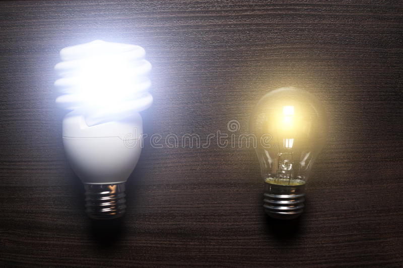 Download Energy Saving Lamp And Glow Lamp Switched On Stock Image - Image: 28081347