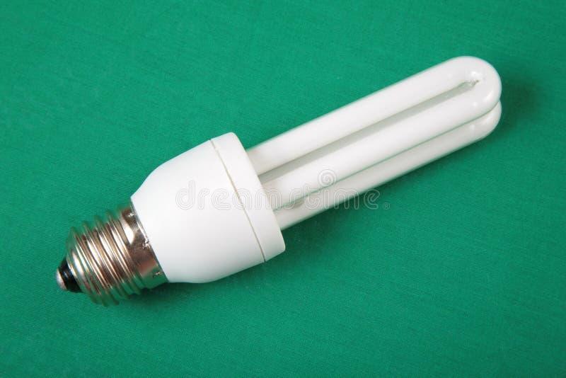 Energy-saving Lamp On Green Royalty Free Stock Photo