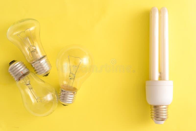 Energy-saving lamp vs. incandescent lamps. royalty free stock photo