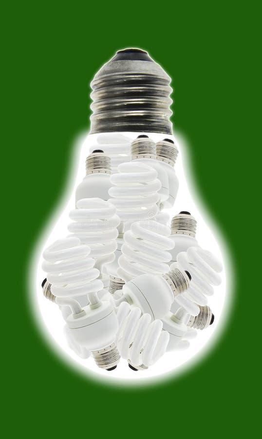 Energy saving light bulbs consume less power. Conceptual image of a group of energy saving light bulbs inside incandescent bulb royalty free stock photography