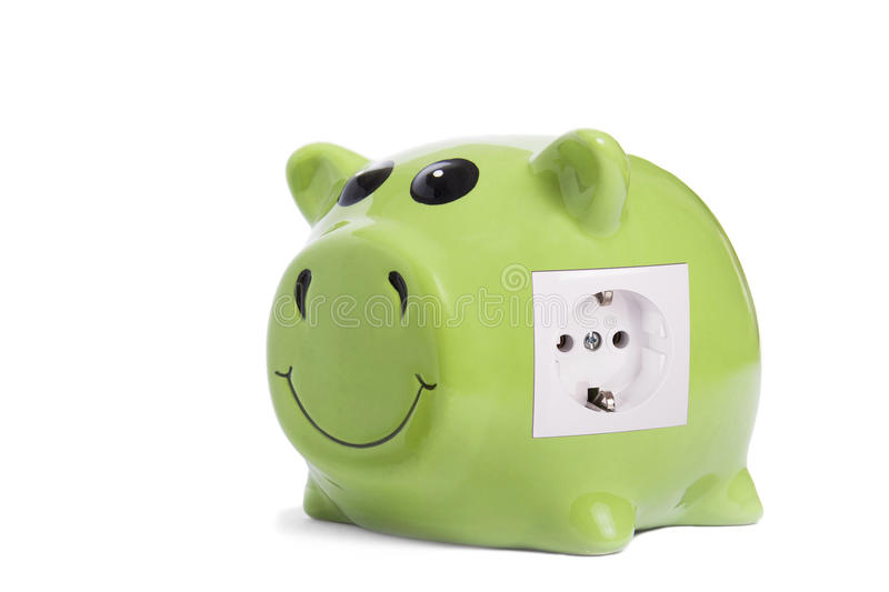 Energy savings. Close up of piggy bank with power inlet as energy savings concept stock images