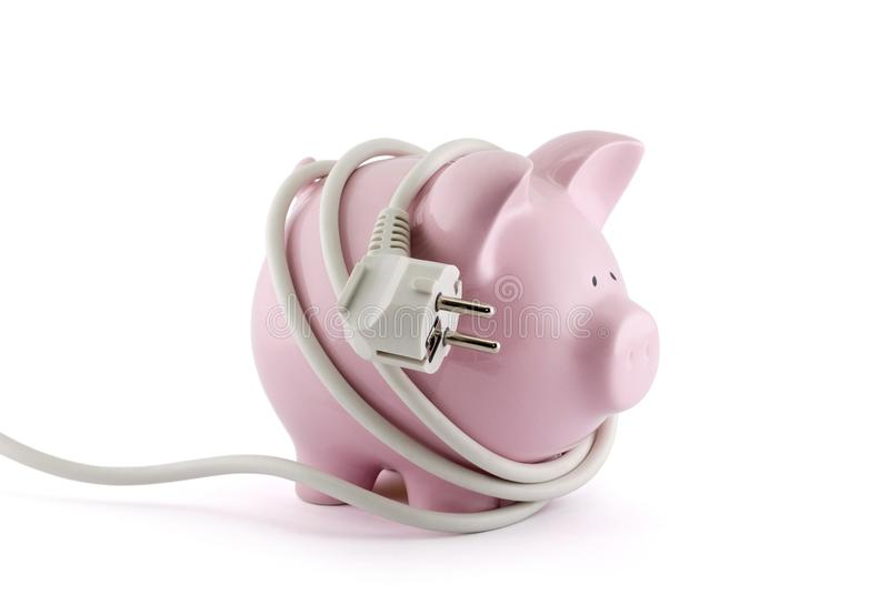 Energy Savings concept. Piggy bank with power plug. Clipping path included royalty free stock image